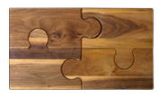 Novelty 4 piece walnut puzzle cutting board